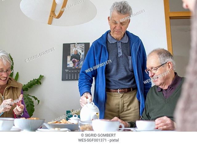 Seniors of a flat-sharing community at tea-time