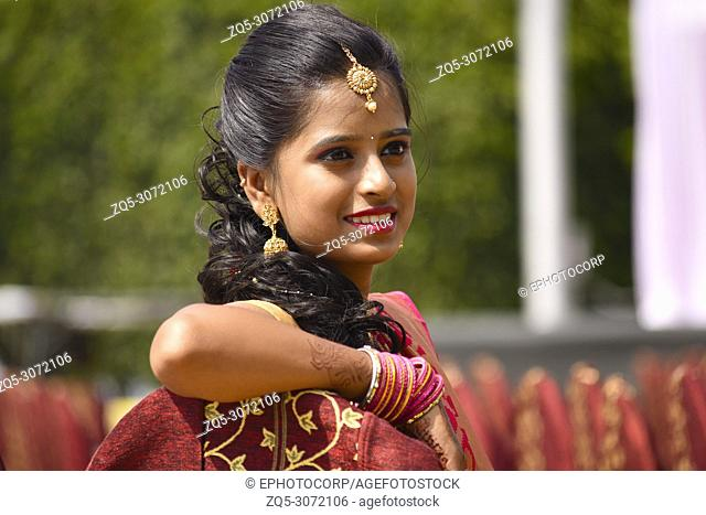 Close up of woman dressed in Indian attire and jewelry, Pune