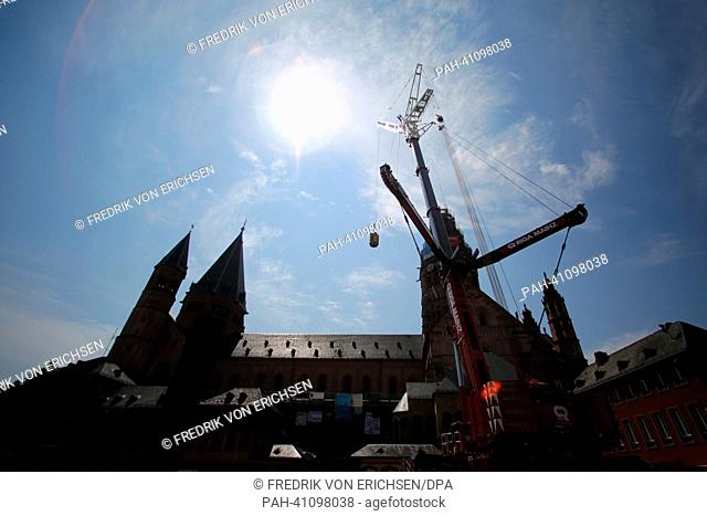The tip of the steeple of the cathedral is replaced with the help of a crane in Mainz, Germany, 17 July 2013. The gigantic project of replacing the steeple of...