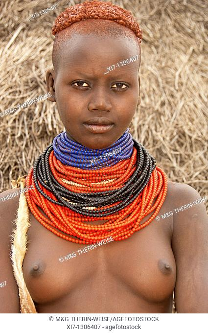Young Karo woman with lots of colorful necklaces, Omo river valley, Southern Ethiopia