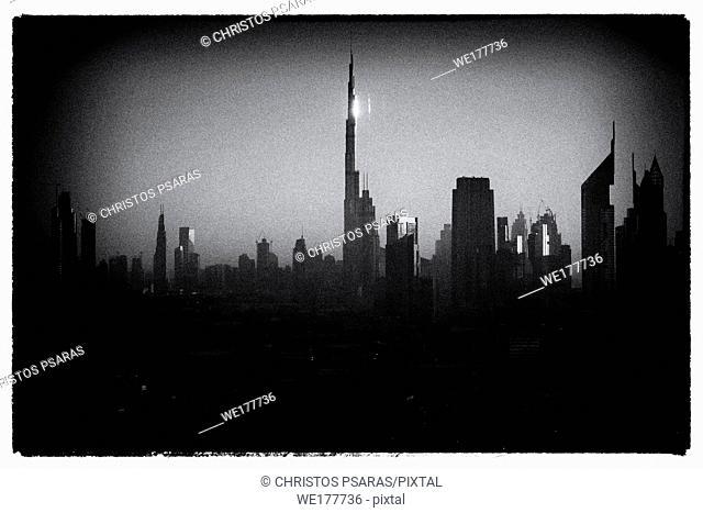 Black and white image of burj Khalifa among skyscrapers of Dubai city