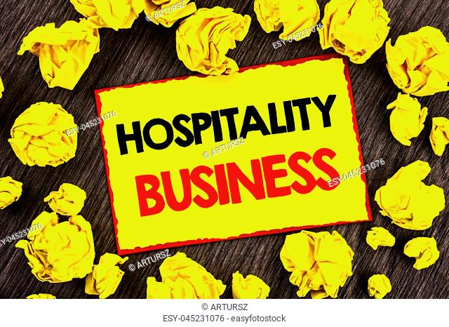 Handwriting Announcement text Hospitality Business. Conceptual photo Industry Business Tourism Advertisement written Yellow Stikcy Note Folded Paper the wooden...