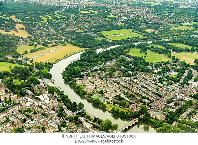 UK, England, London. Aerial view of small village outside London. From the final approach of jet landing at Heathrow Airport