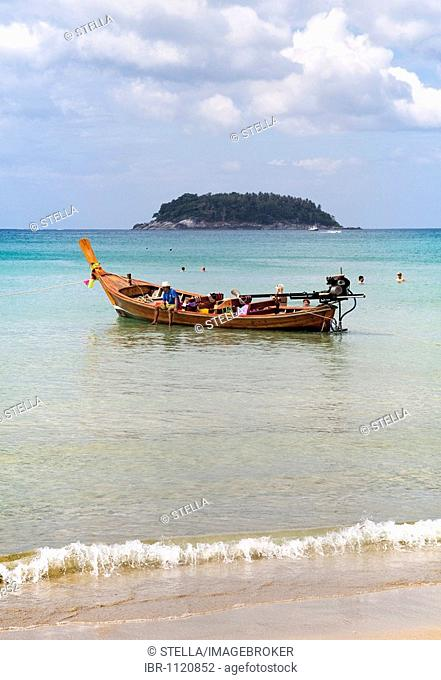 Long-tail boat close to the beach Kata Phuket Island Southern Thailand Southeast Asia