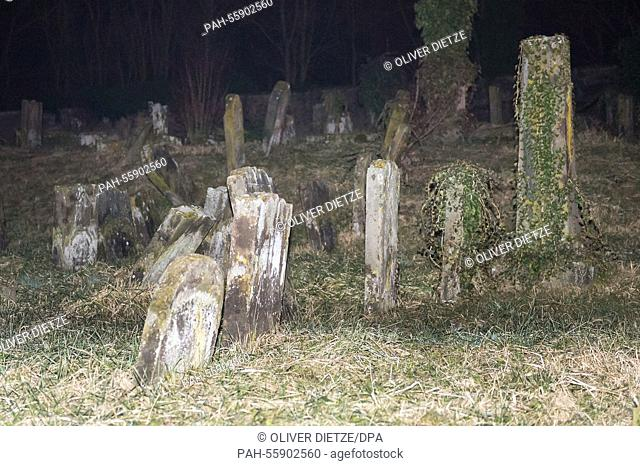 Toppled gravestones are seen at the Jewish graveyard in Sarre-Union, France, 15 February 2015. Several hundred of Jewish graves have been desecrated