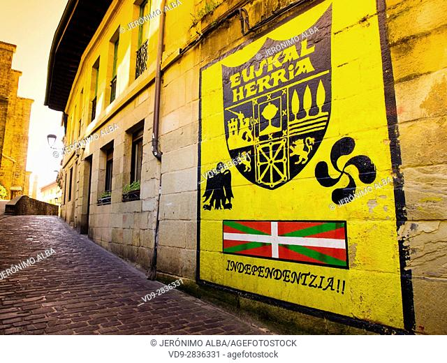Pasai Donibane. Street with a wall painting about the Independance of the Basque Country (Euskal Herria). Fishing village of Pasajes de San Juan