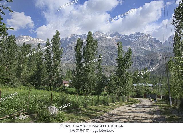 High alpine peaks behind the walnut village of Arslanbob, Kygyzstan