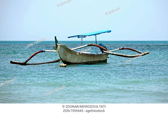 Lonely boat at ocean. Bali. Indonesia