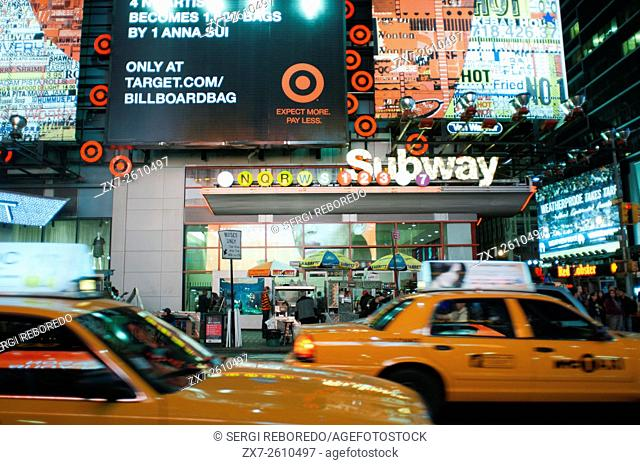 Taxis around Times Square Subway. 1560 Broadway, between 46th and 47th Street . Nearly thirty million visitors a year pass through this area of â. ‹â