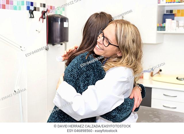 medical care, young female doctor hugging patient. Empathy concept