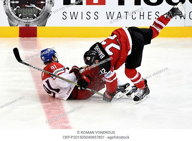 From left: Martin Erat (CZE) and Tyson Barrie (CAN) in action during the Ice Hockey World Championship Group A match Czech Republic vs Canada in Prague