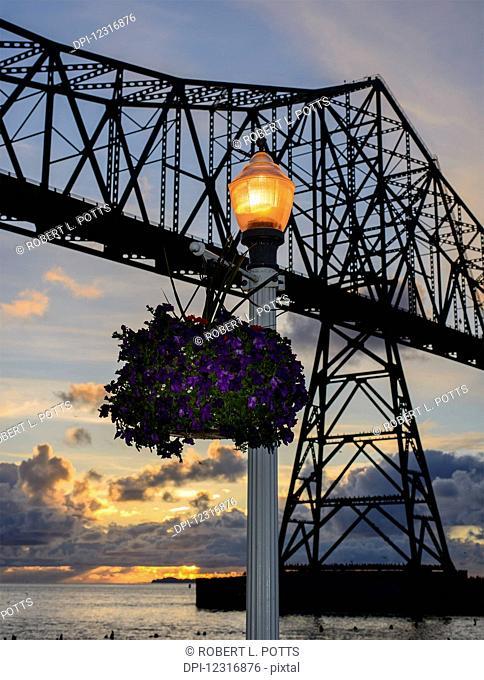 The sun sets at the Astoria-Megler Bridge; Astoria, Oregon, United States of America