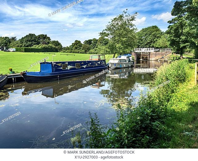 Narrowboat and Riverboat in the Ripon Canal below Rhodesfield Lock Ripon North Yorkshire England