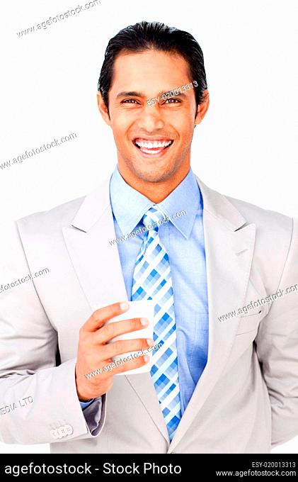 Portrait of a smiling businessman holding a drinking cup
