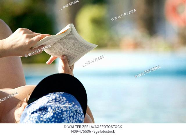 Reading in swimming-pool
