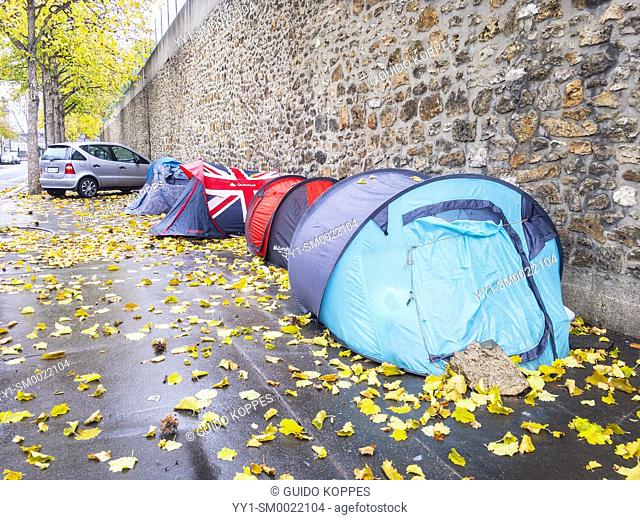 Paris, France. Tents alongside a wall, housing legal and illegal immigrants and asylum seekers who cannot find proper housing