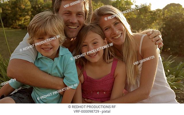 family group looking at camera