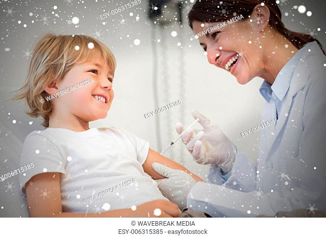 Composite image of child receiving an injection