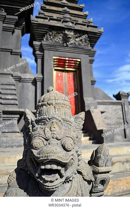Statue in Hindu temple at the foot of Mount Bromo on Java. Guardian statues