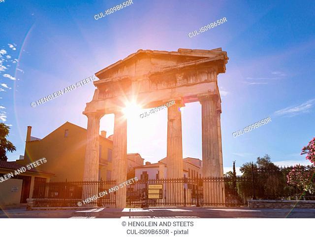 Sunlight on gate of athena archegetis ruins, Athens, Attiki, Greece, Europe