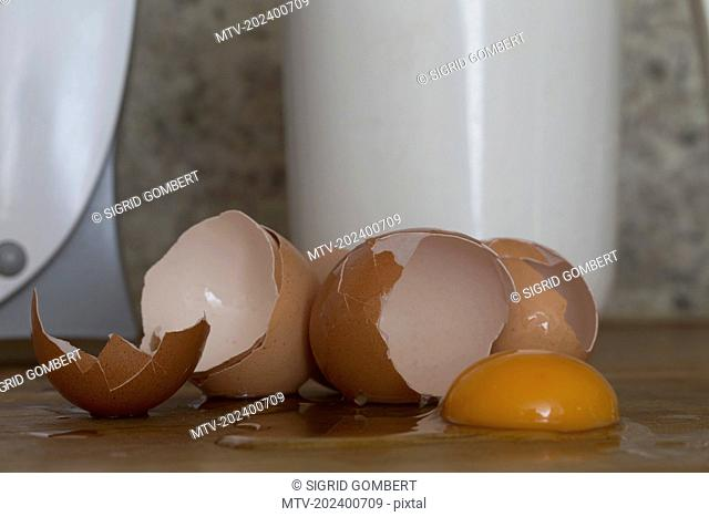 Cracked eggs spreading on table