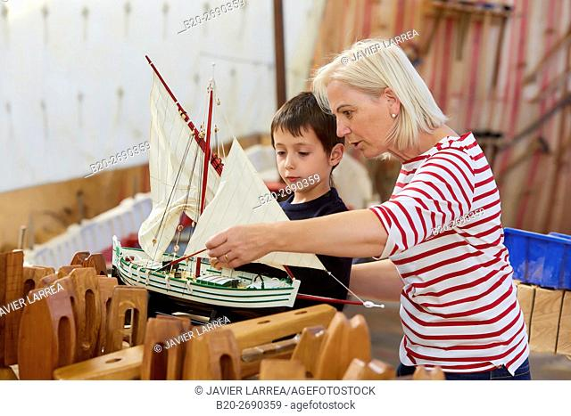 Grandmother and grandson, Building model sailboat, Whaleship, Pasaia, Gipuzkoa, Basque Country, Spain, Europe