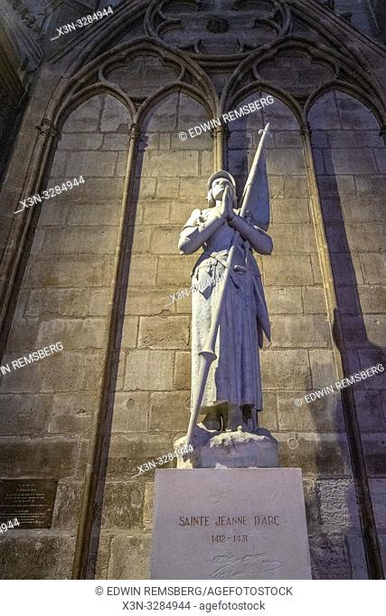 19th-century statute of Joan of Arc by Charles Desvergnes inside Notre-Dame de Paris, medieval gothic cathedral in Paris, France