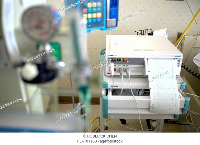 Intravenous and Contraction Machines in Hospital Room