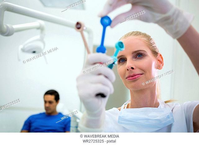 Dentist looking at dental tools