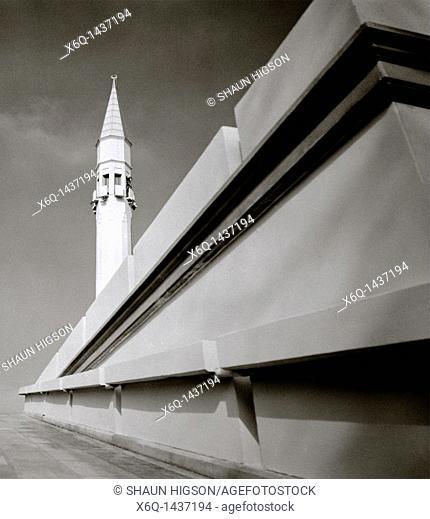 A minaret of the contemporary Sakirin Mosque in Karaca Ahmet Cemetery in Uskudar, Istanbul, Turkey