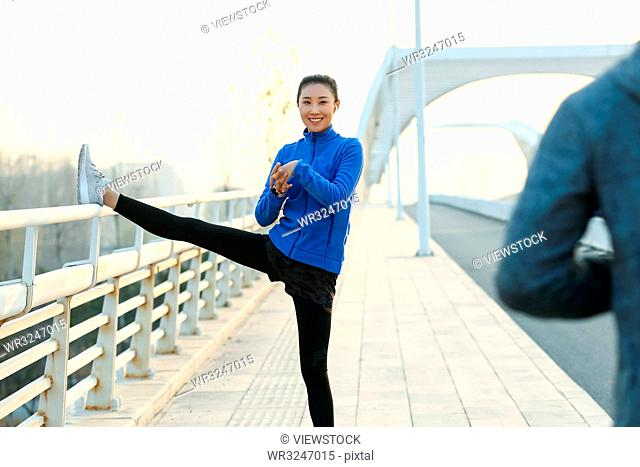 Young men and women outdoor exercise