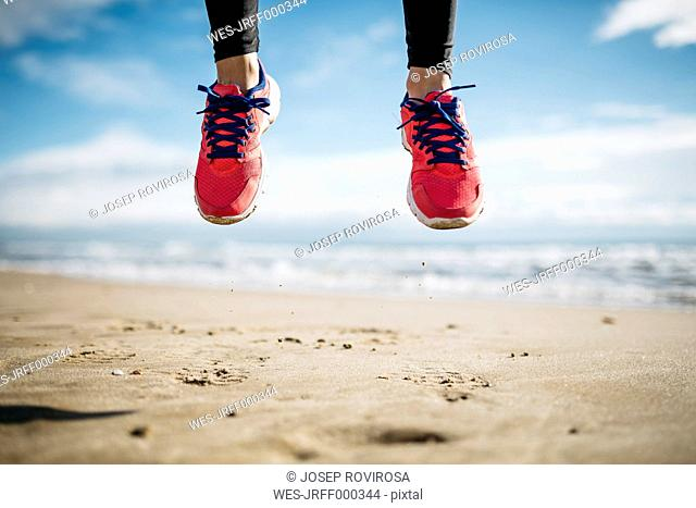 Jump a few feet shod in sneakers, on the beach