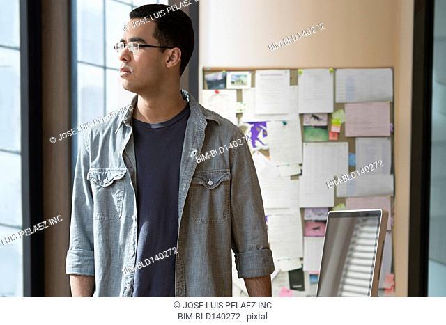 Hispanic businessman standing in office