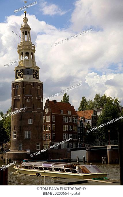 Historical landmark and tour boat in Amsterdam