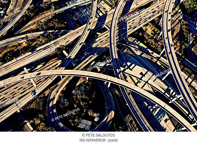 Aerial view of sunlit curved flyovers and highways, Los Angeles, California, USA