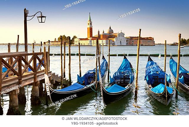 Venice - Grand Canal (Canal Grande), Grand Canal - venetian gondola moored at the molo San Marco, Venice, Italy, UNESCO