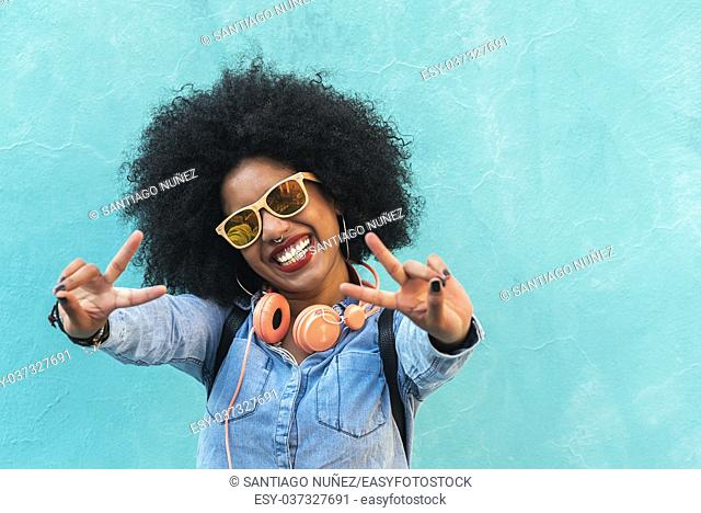 Beautiful afro american woman making peace sign with her hands
