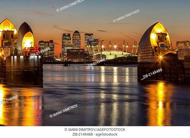 Thames Barrier,Canary Wharf and The Millennium Dome at night,London,England