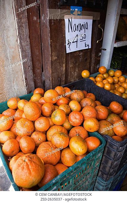 Oranges for sale at the entrance of a shop, San Miguel de Allende, Guanajuato state, Mexico, Central America
