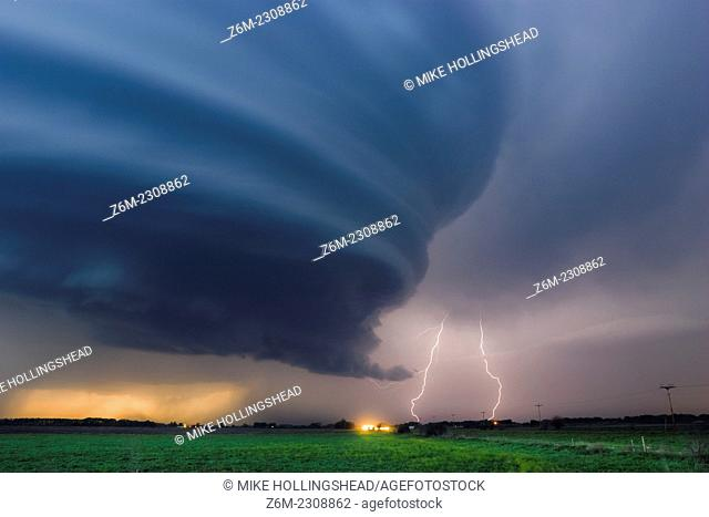 Striated supercell passes just north of Grand Island Nebraska May 10, 2005 producing large hail and lightning during twilight
