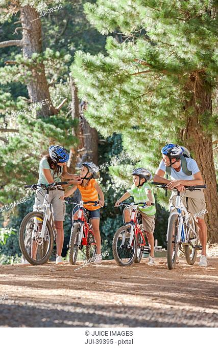 Family on mountain bikes in woods