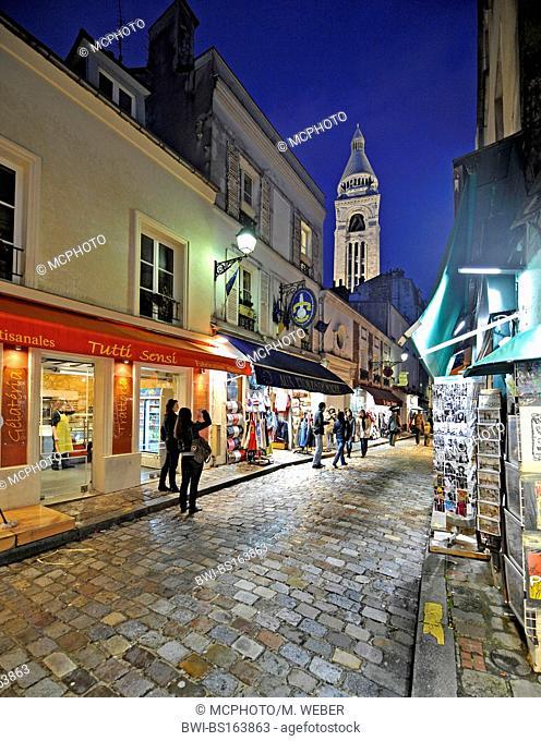 cobbled street at Montmartre, Sacre Coeur in background, France, Paris