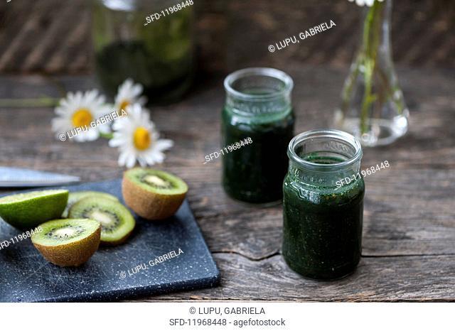 Green smoothies made with chlorella, spirulina, kiwi, limes and parsley
