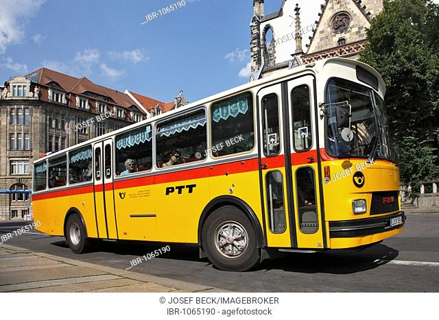 City tour with Swiss post office bus, vintage car tours in Leipzig, Thomas Church, Leipzig, Saxony, Germany, Europe