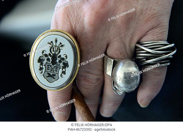 dpa-exklusive: The hand of artist Wolfgang Flatz with a ring with his family's coat of arms on the roof of the Kistlerhof, his roof sculpture garden Heaven 7