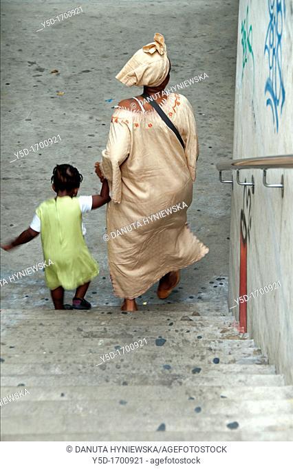 mother and her little daughter, hand in hand, Geneva, Switzerland