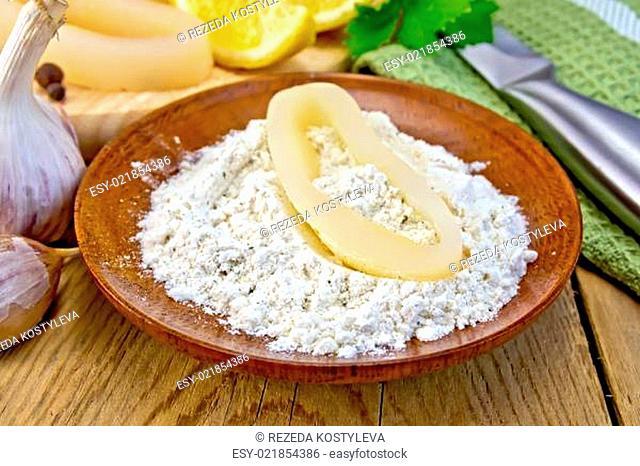 Calamari ring in flour on board