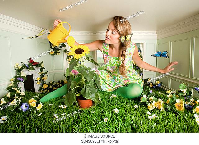 Young woman with garden in small room