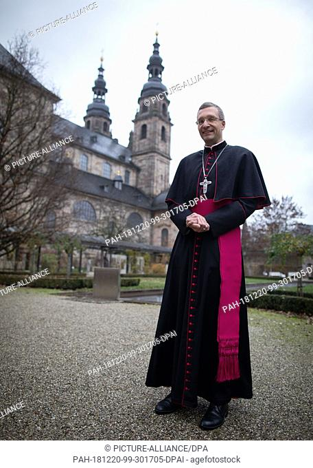 20 December 2018, Hessen, Fulda: The recently appointed bishop of Fulda, Michael Gerber, stands in front of the cathedral after a service