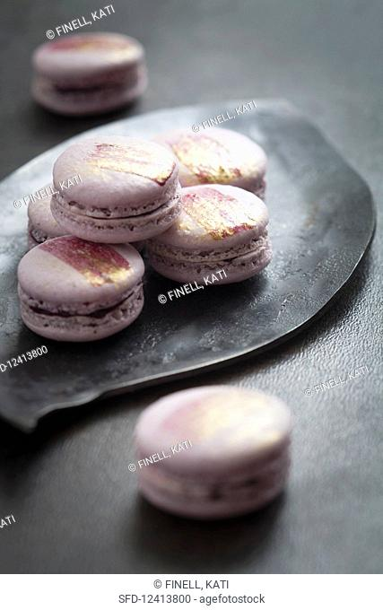 Homemade macarons with golden decoration